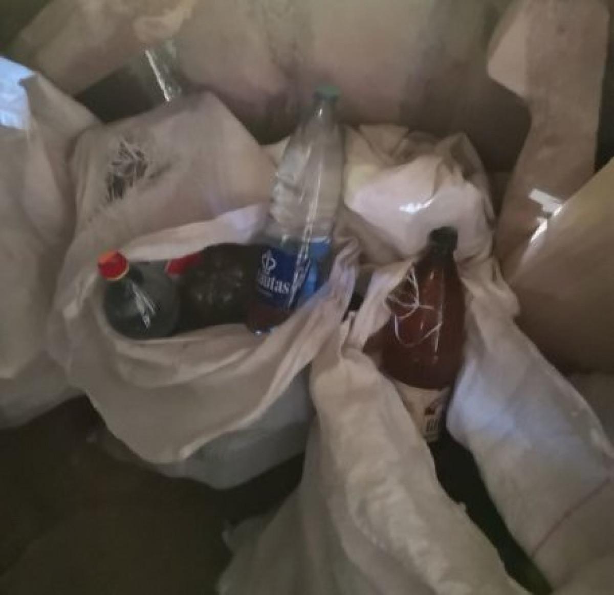 Klaipėdos raj. su 20 litrų naminės degtinės pagautas vyriškis pripažintas kaltu, atimtas ir automobilis